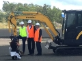 Ipswich mayor Paul Pisasale posing next to Brent's excavator - Coles Supermarket Ripley