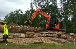 Building a rock wall and levelling a pad - Sunshine Coast