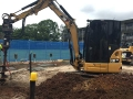 5t Excavator Drilling Holes - Mansfield State High School