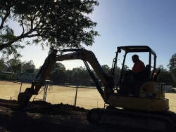 Jodie rising with the sun in the 5t excavator - Goodna Soccer Club