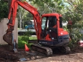 Dennis cutting a driveway in his 4t excavator - Mt Gravatt