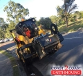 Versatile machine working the roads - Indooroopilly