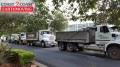 Loading mud into five trucks - Brisbane Airport