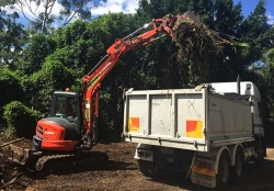 Loading green waste after vegetation clearing - Aveo Retirement Home