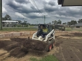 Craig spreading top soil - Bobcat