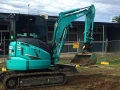 3t Excavator digging trenches at school - Rosewood High