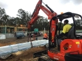 Adrian moving trusses in his new 5t Kubota - Mango Hill