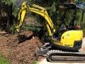 Spreading Mulch for Australian Wetlands - 4t Digger