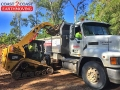 Posi track loading trucks - Indooroopilly
