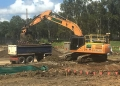 Beastly 30t excavator loading out a truck and dog - Australian Wetlands