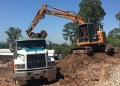 8t Excavator Loading The Tip Truck - John Paul College
